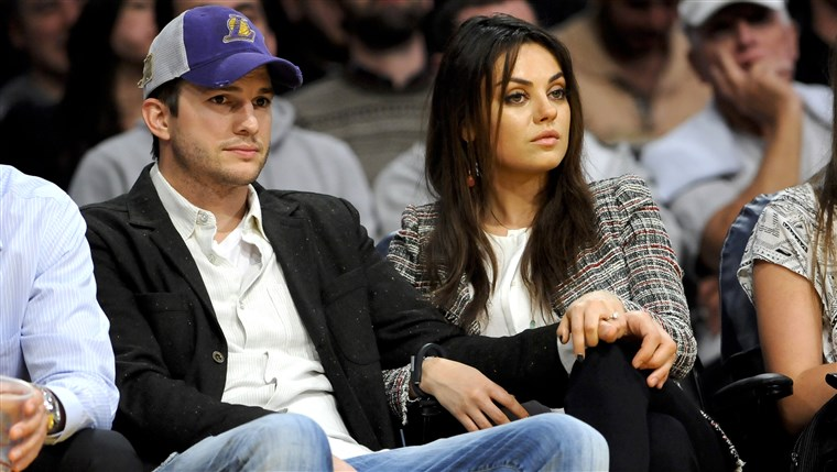 The newly engaged actors Ashton Kutcher and Mila Kunis attend an NBA basketball game between theNew Orleans Pelicans and Los Angeles Lakers, Tuesday, ...