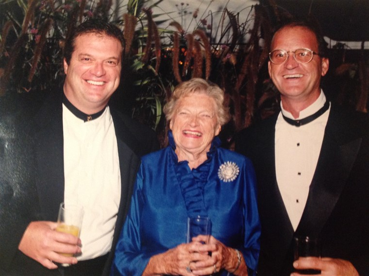 Mary Stocks laughs with two of her sons.
