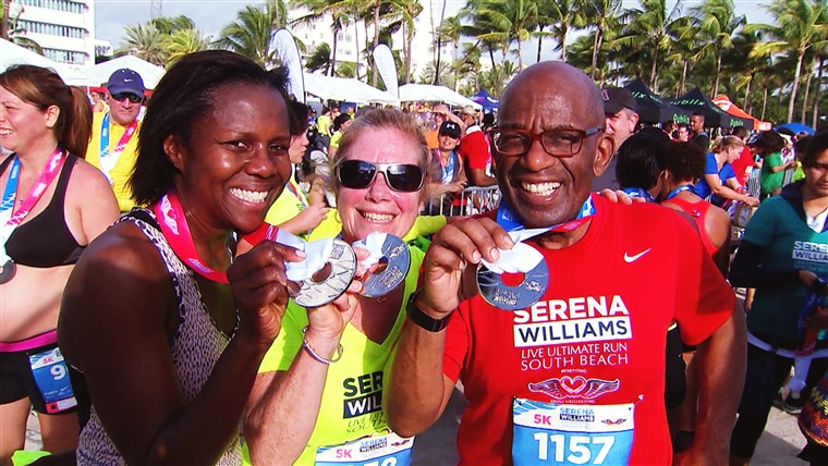 Al Roker and his wife, Deborah, show off their finishing medals with Rothman