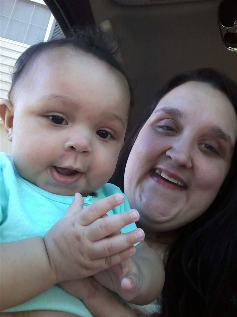 ZA photo of Hannah Simmons holding her infant daughter, A'lannah