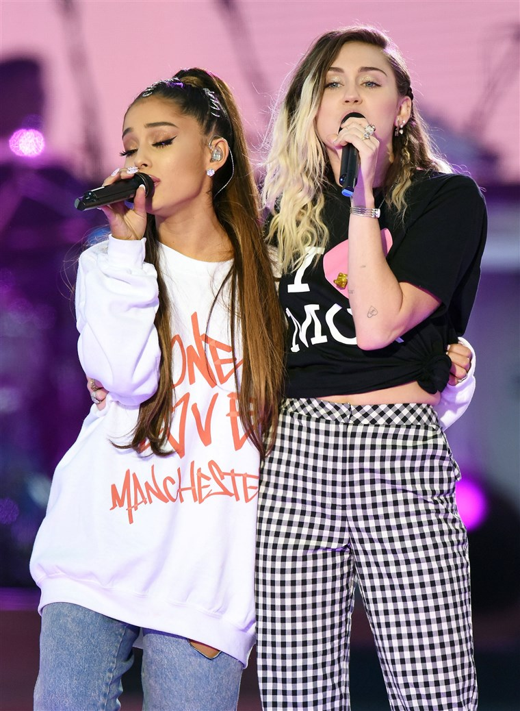 Ariana Grande and Miley Cyrus perform during the One Love Manchester benefit concert for the victims of the Manchester Arena terror attack in Britain