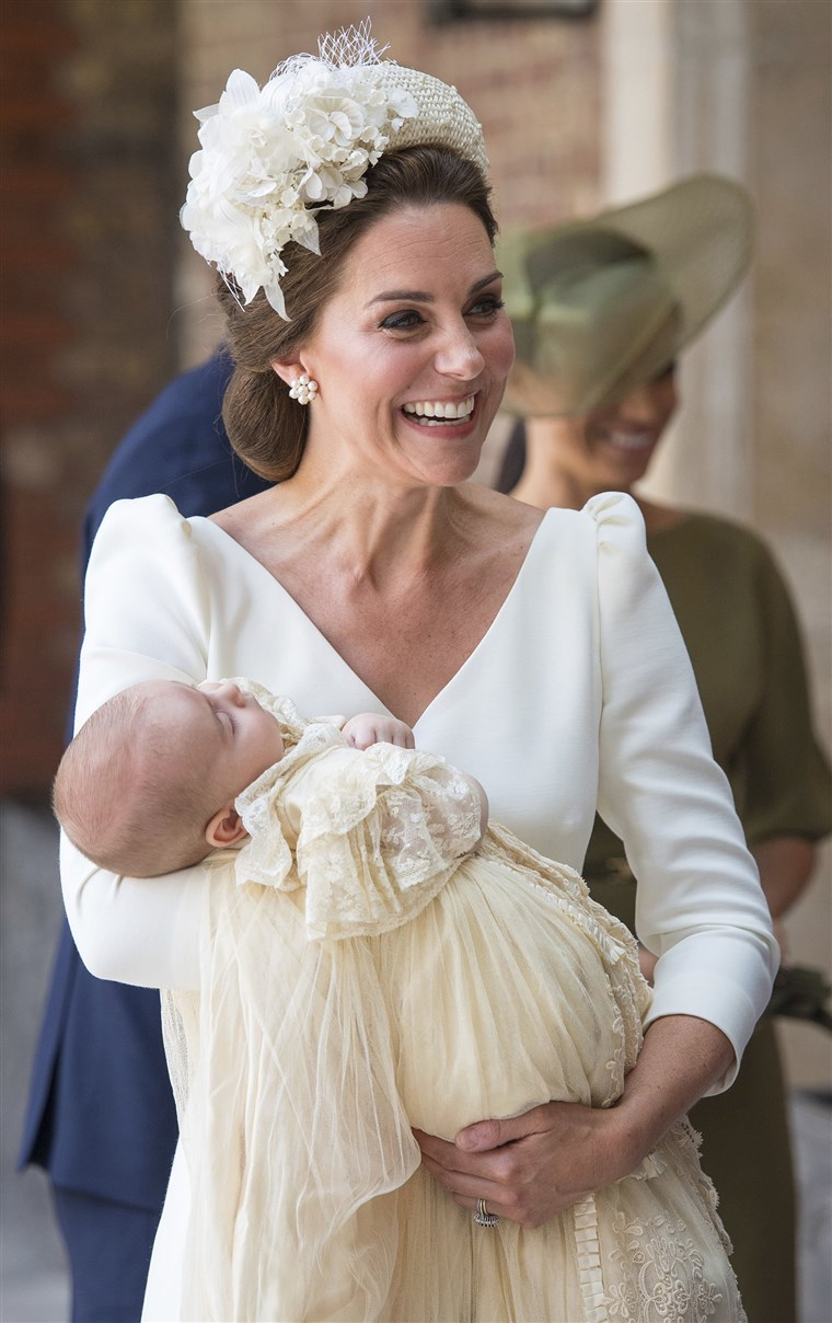 Kate, Duchess of Cambridge carries Prince Louis