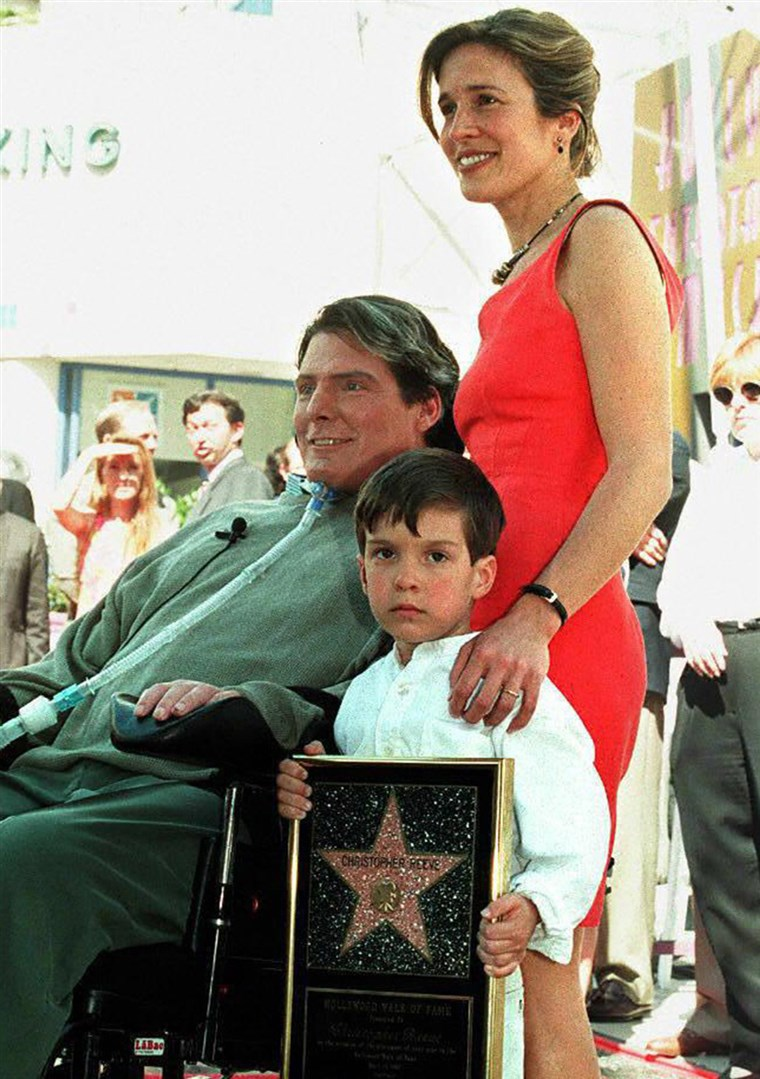 LOS ANGELES, UNITED STATES: Actor-Director Christopher Reeve poses for journalists with his wife, Dana, and their son, Will, after being honored with...