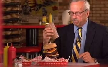 NBC's George Lewis prepares to try the 8,000-calorie burgers, fries and shake.