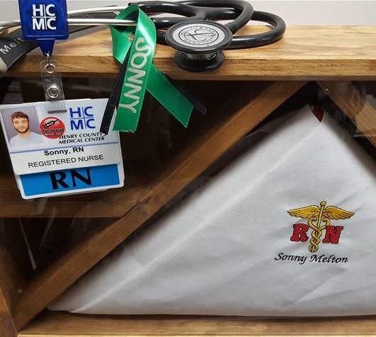 Synek's personal items, including his identification badge for the hospital where he worked as a nurse.