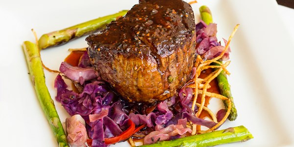 Tim Love's Easy Grilled Steak Stuffed with Roasted Garlic