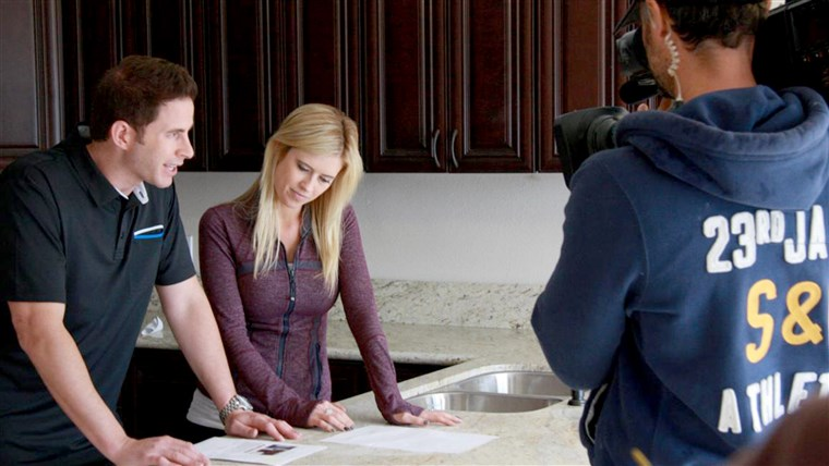 mann and wife team, Tarek and Christina El Moussa, discuss renovation plans on the set of HGTV's Flip or Flop.