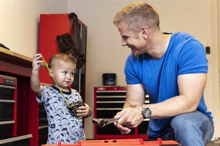 Sean Lowe and his son Samuel in their new garage by Lowe's, in partnership with Craftsman.