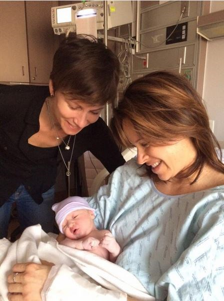 E baby makes... 4! Jenna and Steph hold Quinn in the hospital.