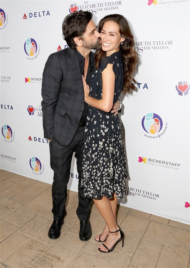 John Stamos and Caitlin McHugh attend The Elizabeth Taylor AIDS Foundation and mothers2mothers dinner in October.