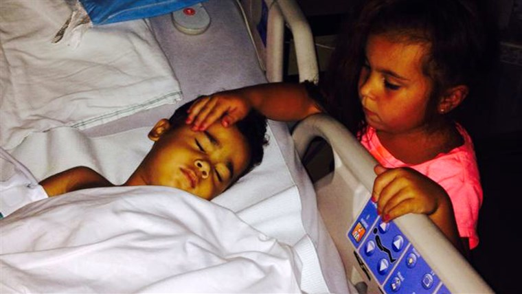 Johanna Colon, 6, with her little brother CJ, who has a rare disease