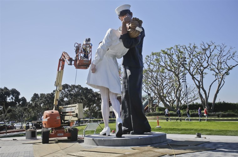 afwerking touches are made to the new kissing sailor statue on the embarcadero adjacent the USS Midway museum in San Diego. The statue, which was modeled after the renowned photograph by Alfred Eisenstaedt taken at the end of World War II, replaces a similar version that was moved out of San Diego last year.