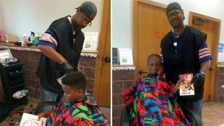 Fryzjer Courtney Holmes, who gave away free haircuts to children in exchange for them reading him stories at a community back to school festival last weekend.