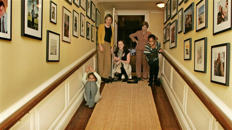 Laura Bush, Jenna Hager and Barbara Bush welcome Michelle Obama, her mother, Marian Robinson, and her children Malia and Sasha for a tour of the White House. The girls slide down the ramp, Private Residence.