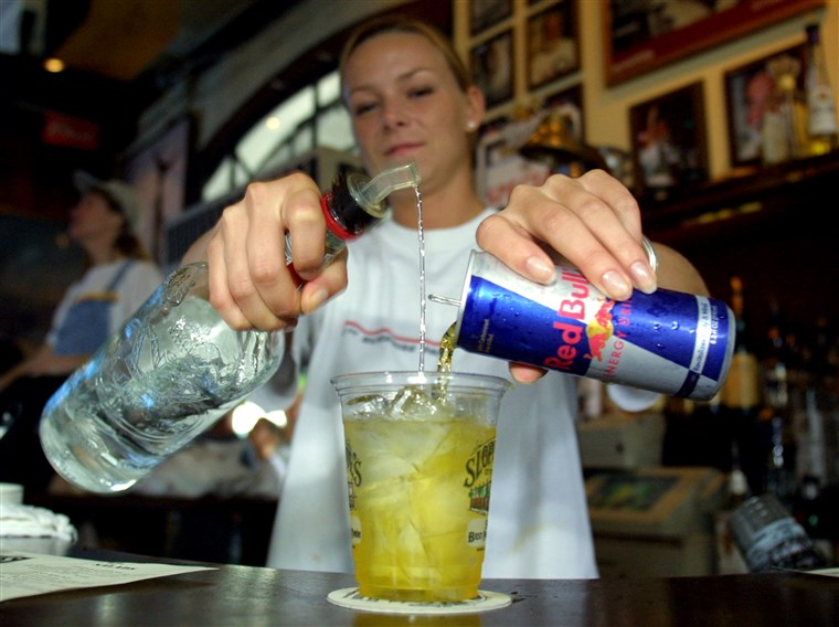 392259 02: Sloppy Joe''s Bar Tender Crystal Petersen mixes a Red Bull energy drink with vodka July 22, 2001 in Key West, FL. The popular energy drink ...