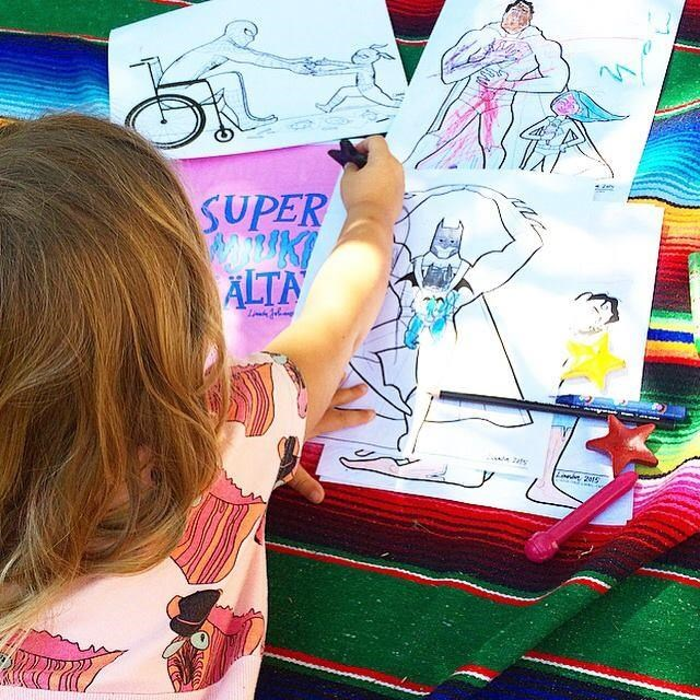 Dzieci color drawings that show everything from Batman wearing a baby to Spider-Man in a wheelchair.