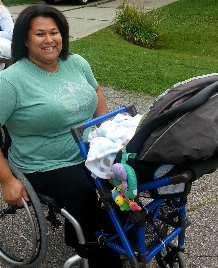 Jones on a walk with son, Grover, using the wheelchair stroller attachment designed by Alden Kane.