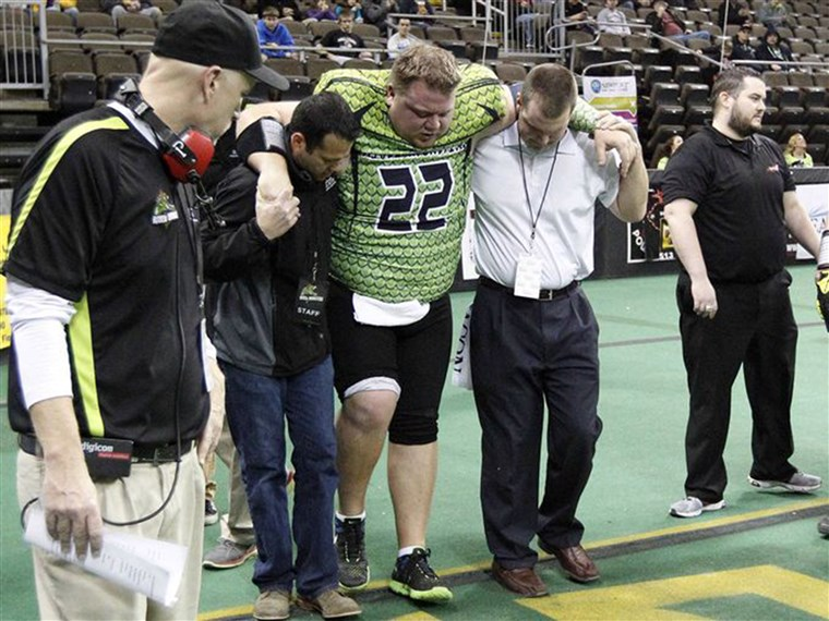 Lorenzen helped off the field after breaking his ankle in his last professional game in the Continental Indoor Football League.