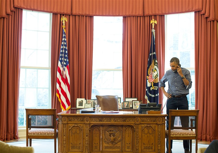 President Barack Obama talks on the phone in the Oval Office with Russian President Vladimir Putin about the situation in Ukraine, March 1, 2014.(Off...