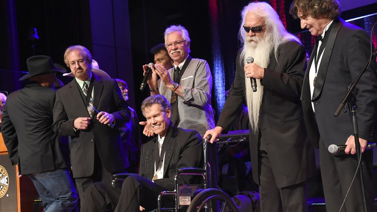 Duane Allen, William Lee Golden,Joe Bonsall, and Richard Sterban of The Oak Ridge Boys perform onstage with inductee Randy Travis