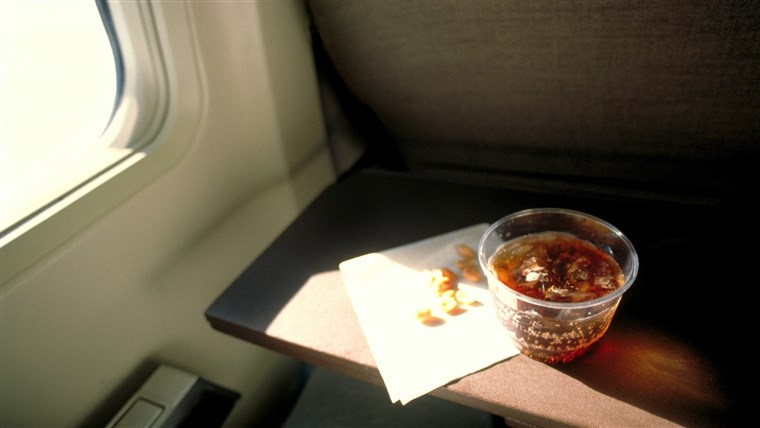 Soda and peanuts on airplane