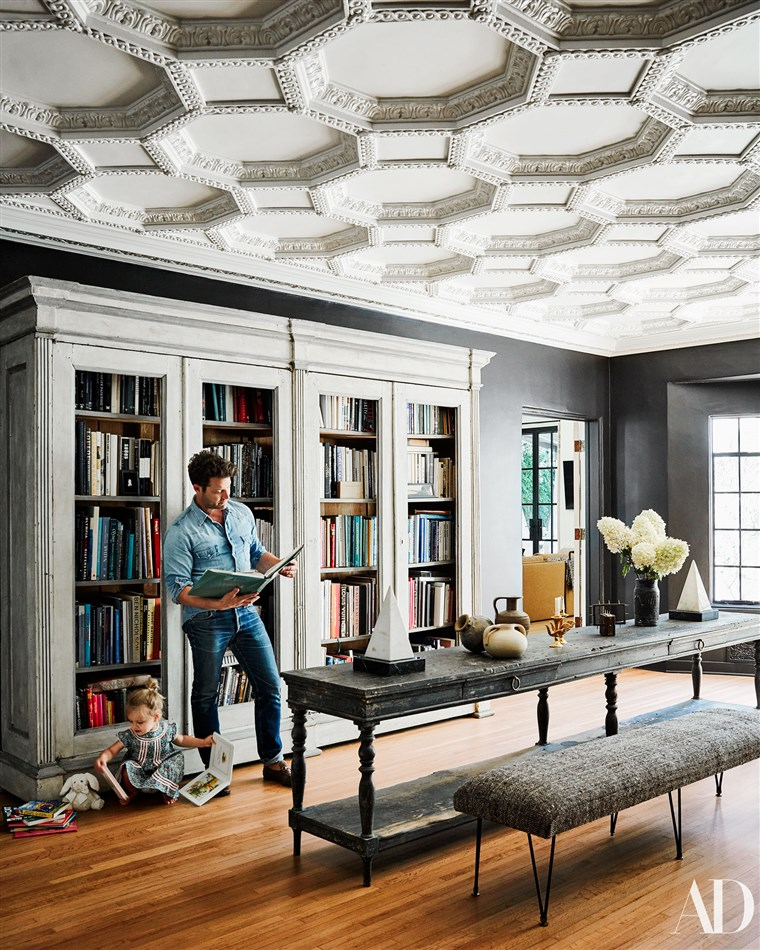 Nate Berkus and daughter Poppy in their home's gallery.