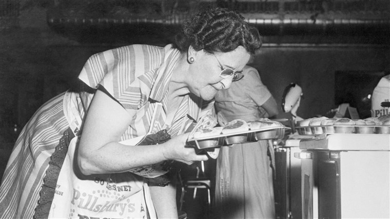 EN participant pulls her 80 minute bicuits fresh out the oven during the 1949 bake-off.