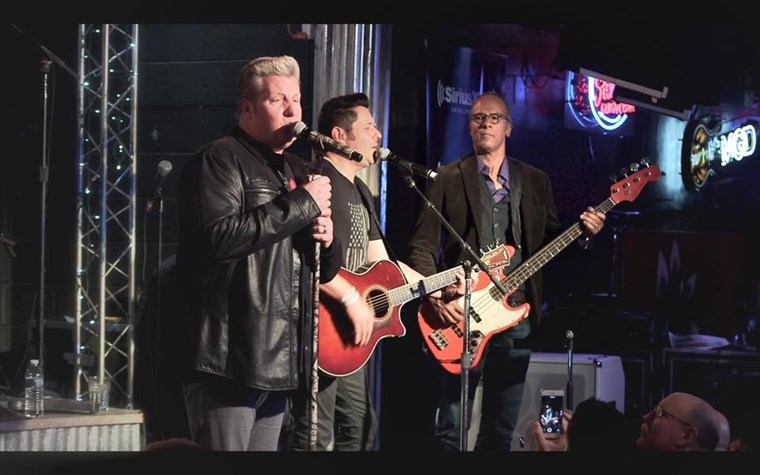 HARI INI's Lester Holt joins The Rascal Flatts on stage at the Diffle and Steel Guitar Grill in Nashville.