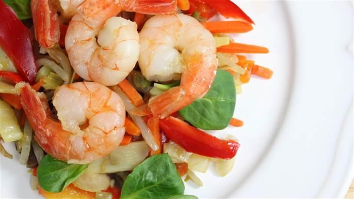Fried shrimp on a salad of steamed vegetables; Shutterstock ID 129319094; PO: today.com
