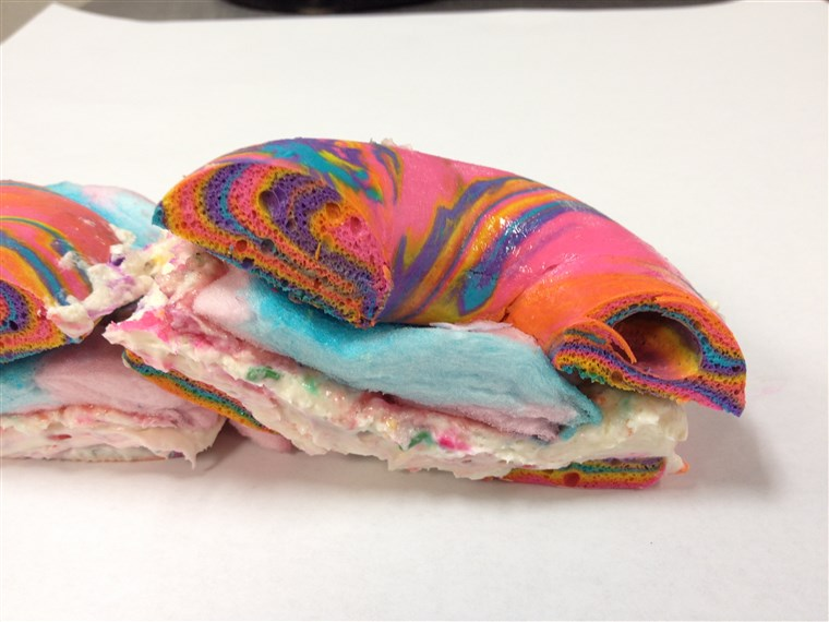 Krzyż Section of Rainbow Bagel Stuffed with Funfetti Cream Cheese and Cotton Candy from Brooklyn's The Bagel Store